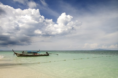 boat isolated on a clear water, Bamboo Island, Thailand