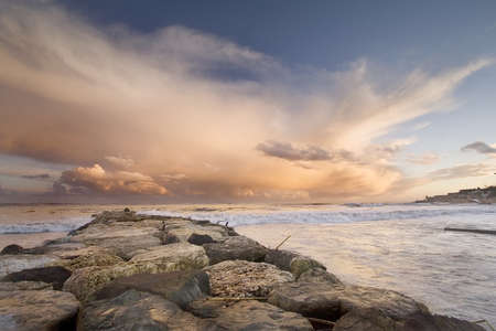beautiful beach with an amazing sunset near Cascais, Portugal