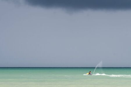 An aquatic motorbike alone at a turquoise water, Phuket Island, Thailand