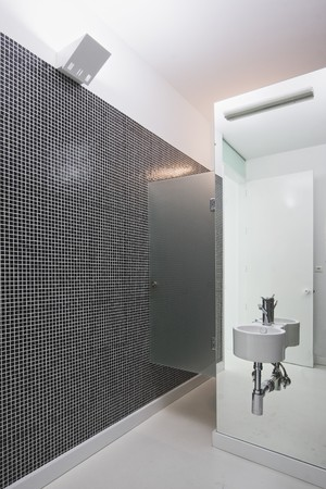 Black and white mosaic at a bathroom with mirror Stock Photo