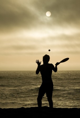 young man playing beach tennis photo
