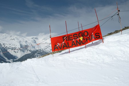 snow landscape with a blue sky and a warning for avalanches, Spain Stock Photo