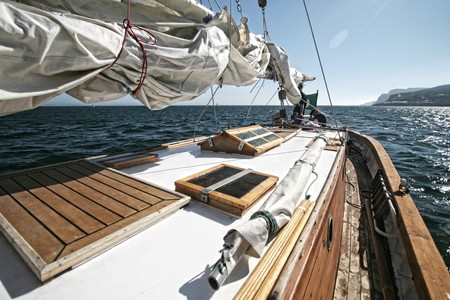 maneuvering: beautiful yacht in the blue sea. A fresh wind and pleasant movement Stock Photo