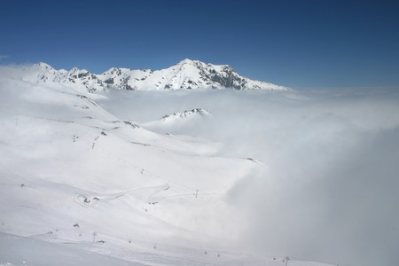 beautiful landscape with a blue sky and clouds covering the snow, Spain