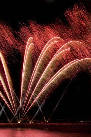 long exposure: long exposure of red fireworks against a black sky Stock Photo