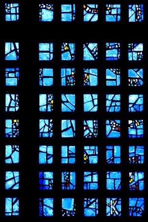 Texture of light stream through a blue stained glass window Editorial