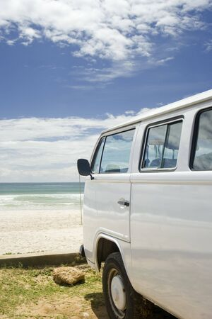 Classic camper van parked by the coast, Brazil photo