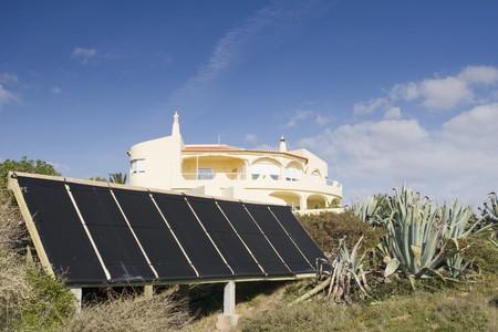 alternative energy sources: Villa with alternative energy sources - photocell board Stock Photo