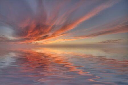 sunset at coast of the sea Stock Photo