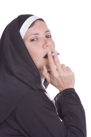 nun: Provocative catholic nun smoking a cigarette Stock Photo
