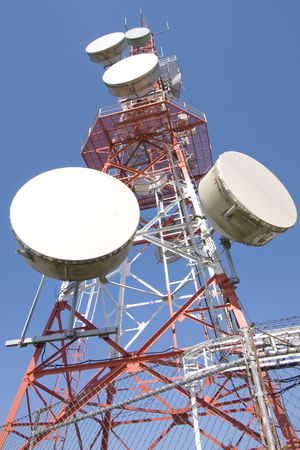 Red and white tower of communications with their telecommunications antennas Stock Photo