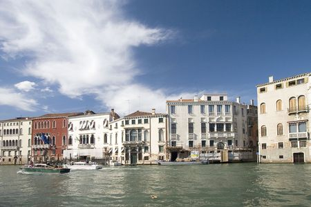Water street with their boats and gondolas. Venice, Italy