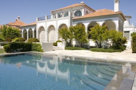 Amazing and beautiful villa with a healthy garden and a refresh water pool, located at Quinta do Lago, south of portugal Stock Photo - 4813111