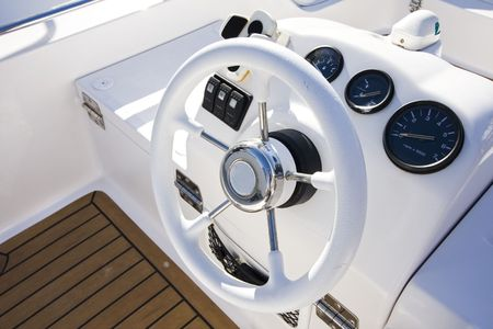 helm: Instrument panel and steering wheel of a motor boat cockpit (yacht control bridge) Stock Photo