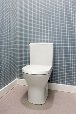 Simple, clean and white toilet in a bathroom photo