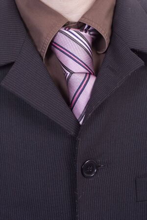 detail of a business man suit with colored tie