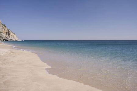 Beautiful view of an idyllic empty beach in summertime