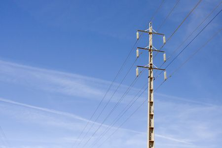 Electricity pole for energy with power lines over a clear blue sky Stock Photo - 6801304