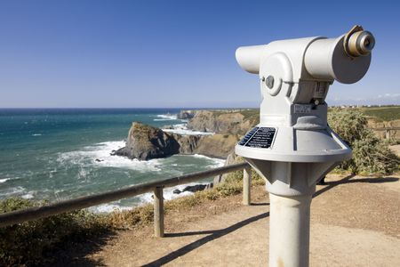 viewpoint: Coin operated telescope in a cosatline viewpoint overlooking the ocean (Pay per view concept) Stock Photo