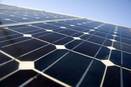 Texture detail of photoelectric cells of a solar panel (Blue and ecology energy) - shallow DOF Stock Photo