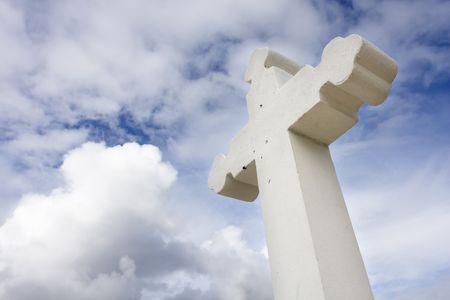Rustic christian cross over a sky with cloud (faith symbol)