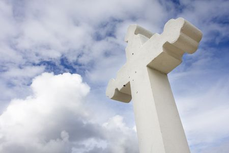 Rustic christian cross over a sky with cloud (faith symbol)