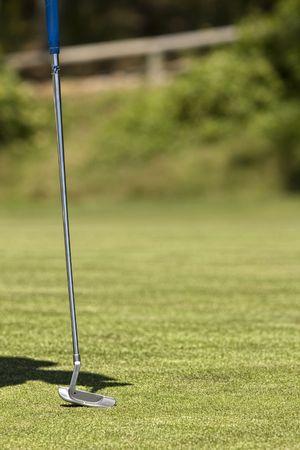 golf equipment on a fresh green golf course, drive