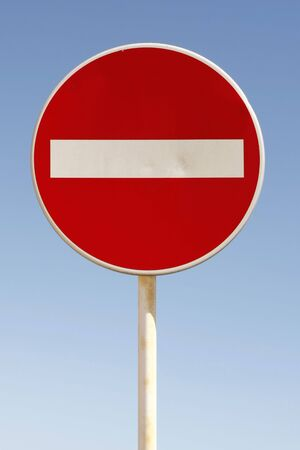 Red and white british no entry road sign with a blue sky Stock Photo - 6800840