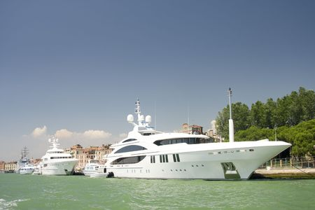 marina water: The large white luxurious yachts alongside the dock at Mediterranean Sea, Italy
