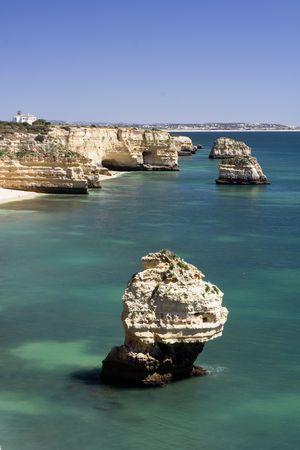 Beautiful view of an idyllic wild beach in summertime - Marinha beach at Algarve, Portugal.
