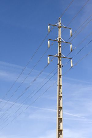 Electricity pole for energy with power lines over a clear blue sky Stock Photo - 6801341