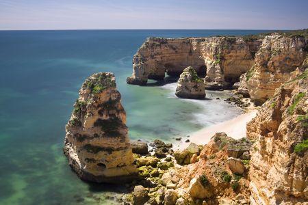 Beautiful view of an idyllic wild beach in summertime - Marinha beach at Algarve, Portugal