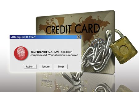 identity theft: typical plastic credit card with identity theft warning Stock Photo