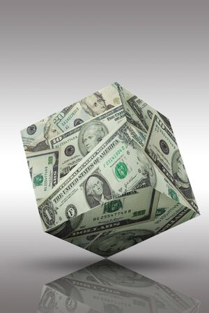 a three deminsional money cube with reflection on a table Standard-Bild