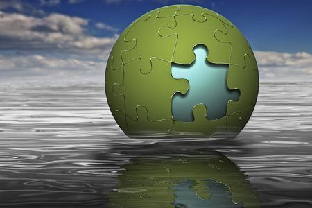 Globe puzzle emerging from water with reflection Stockfoto