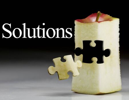 Deliciously juicy cut apple with puzzule piece Stock Photo