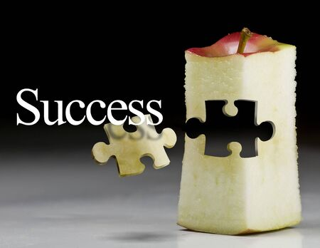 deliciously: Deliciously juicy cut apple with puzzule piece Stock Photo