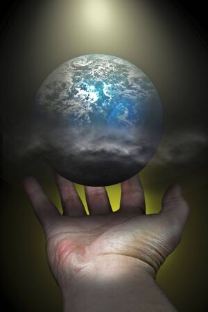 An image of a planet with light and shadows and a hand cupping the planet photo
