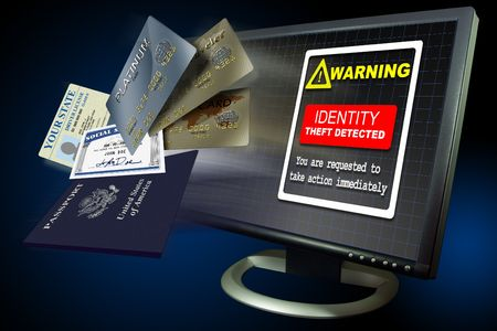 Identity theft warning on a pc monitor with ID papers Stock Photo