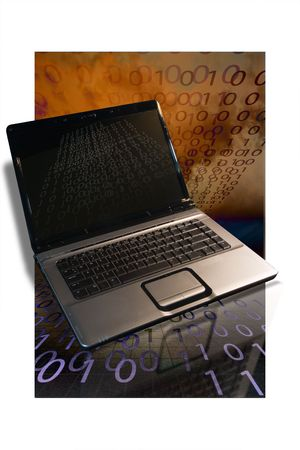 Laptop with binary numbers and refections  on a table photo