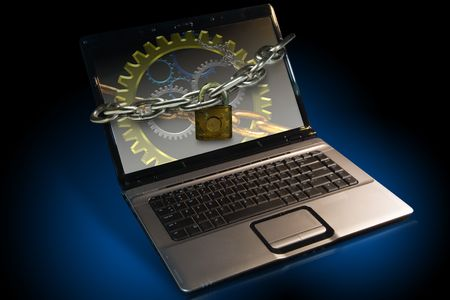 restraint device: Lap top note book Computer locked with chains Stock Photo