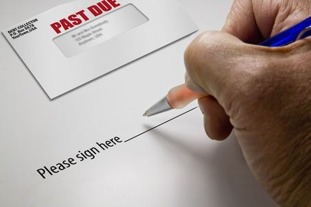 Pen in hand ready to sign a signature regarding a debt photo