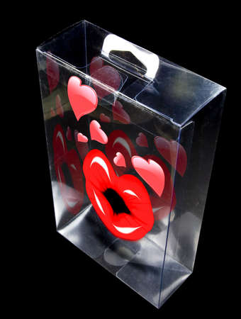 Shinny valentine hearts and lips encased in a plastic display Stock Photo