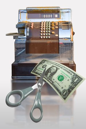 Old cash register with sissors autting a dollar bill