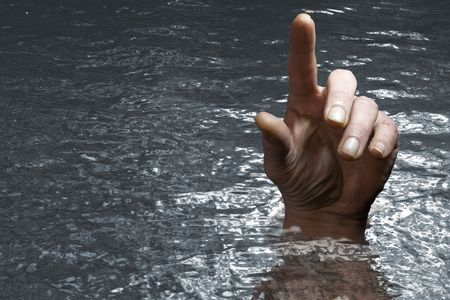 concept image of hand in the water finger pointing