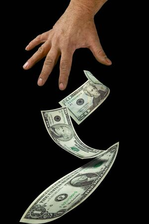 dollar bills and hand suspended in air