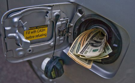 litre: Concept image with gas nozzle filling up with cash Stock Photo