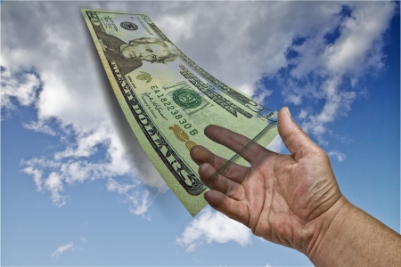 dollar bill and hand suspended in air Stock Photo - 3428507