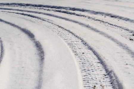Tire tracks in the snow on a rural road  Curves to the left Stock Photo - 21130458