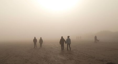 realtionship: couple together misty winter walk on beach